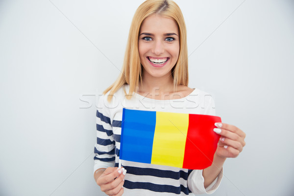 Young girl holding Romanian flag Stock photo © deandrobot