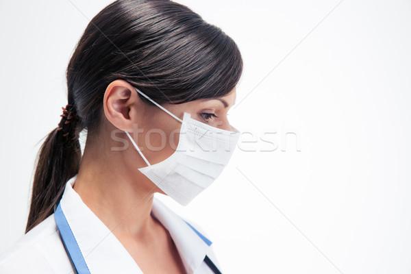 Pensive female medical doctor in mask  Stock photo © deandrobot
