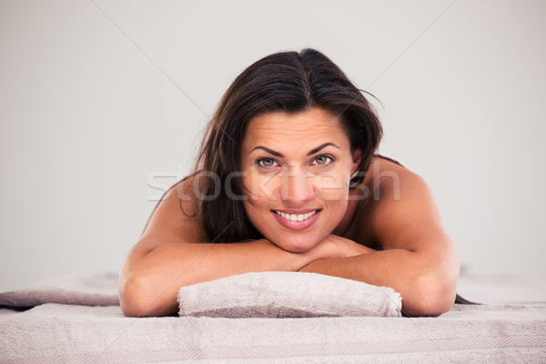 Cheerful woman lying on massage lounger Stock photo © deandrobot