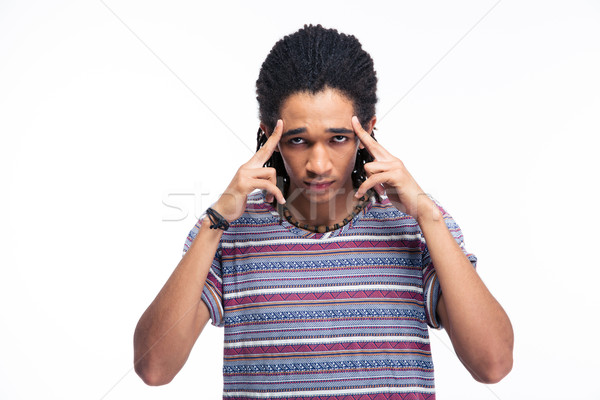 Thoughtful afro american man looking at camera Stock photo © deandrobot