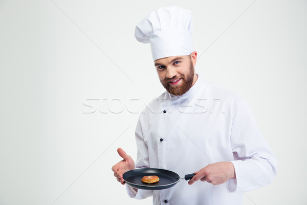 Male chef cook holding pan with pancake  Stock photo © deandrobot