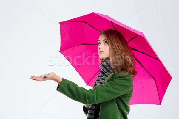 Sad woman with umbrella Stock photo © deandrobot