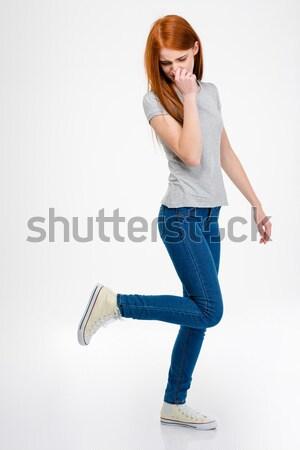 Csinos nő orr kéz lefelé néz csinos fiatal nő Stock fotó © deandrobot