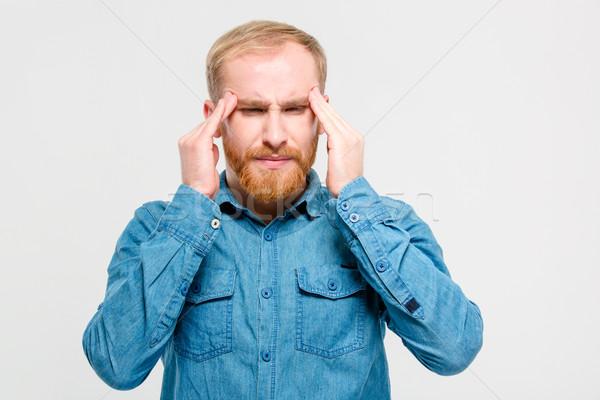 Jonge depressief bebaarde man aanraken hoofdpijn Stockfoto © deandrobot