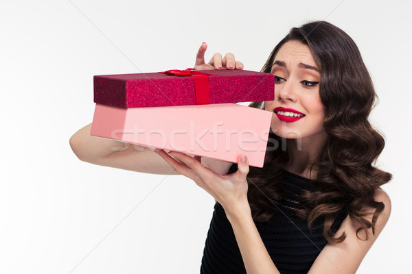 Anticipated attractive curly woman in retro style opening present box  Stock photo © deandrobot