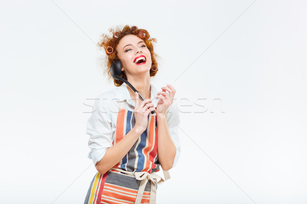 Housewife in apron holding soup ladle  Stock photo © deandrobot