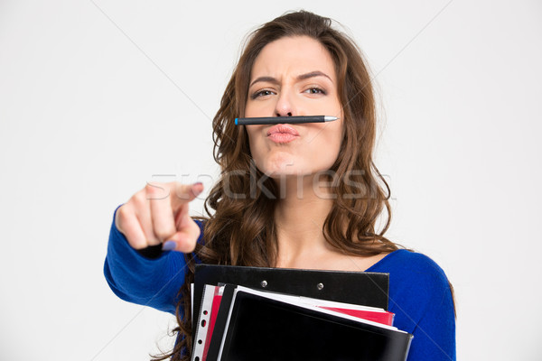 Funny woman simitating moustache with pen and pointing on camera  Stock photo © deandrobot