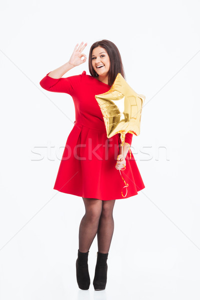 Smiling woman holding balloon and showing ok sign Stock photo © deandrobot