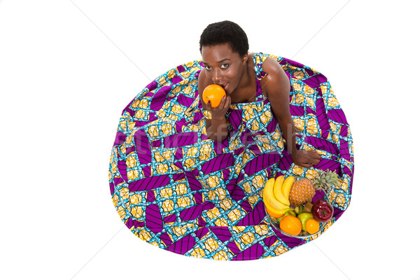 Top view of happy african american woman in colorful sundress  Stock photo © deandrobot