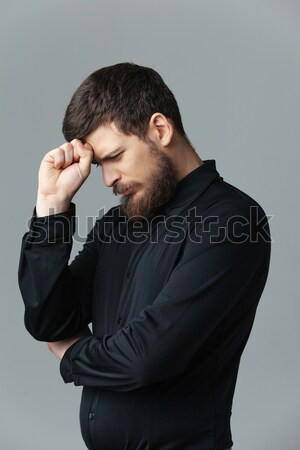 Man in black shirt thinking Stock photo © deandrobot