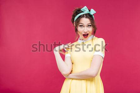 Thoughtful funny young woman guessing fortune using white flower  Stock photo © deandrobot