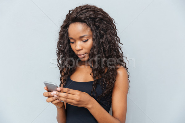 Afro Frau Smartphone grau Hintergrund Stock foto © deandrobot