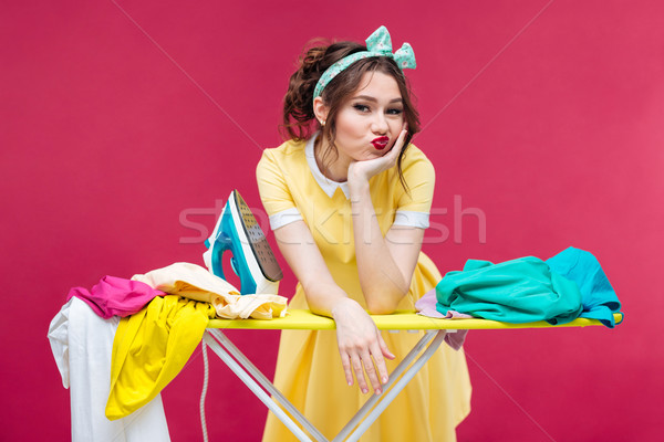 Bored sad young woman ironing clothes Stock photo © deandrobot