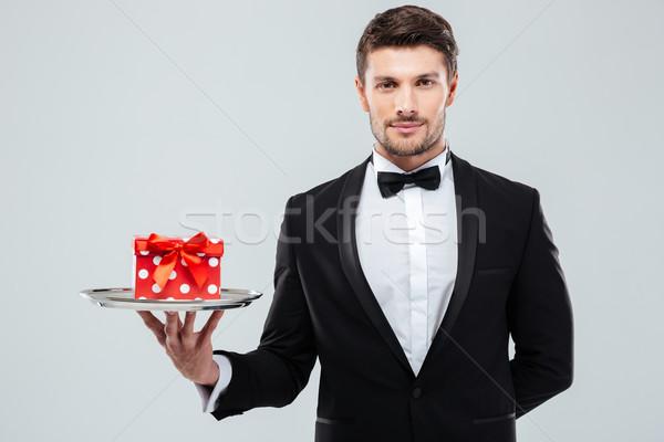 De ober smoking aanwezig vak dienblad Stockfoto © deandrobot