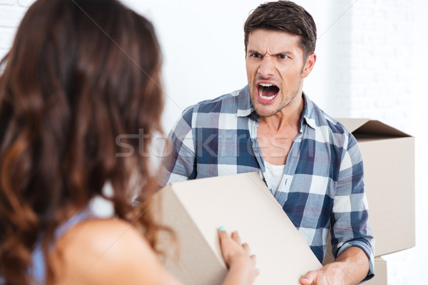 Young married couple arguing during relocation Stock photo © deandrobot