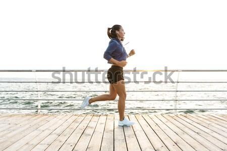 ハンサム アフリカ系アメリカ人 小さな スポーツマン を実行して 桟橋 ストックフォト © deandrobot