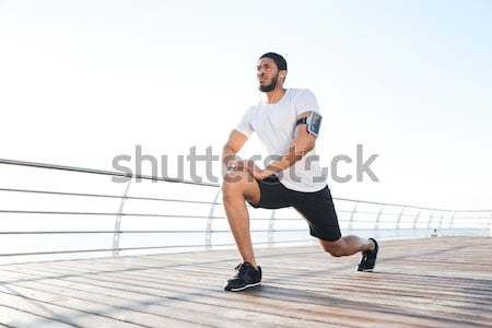 Omhoog benen pier geconcentreerde Stockfoto © deandrobot