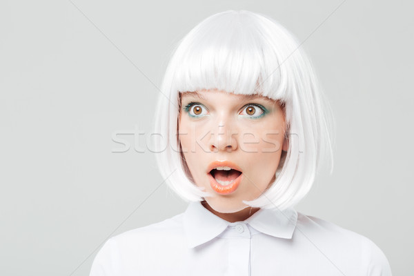 Closeup of amazed pretty young woman with mouth opened Stock photo © deandrobot