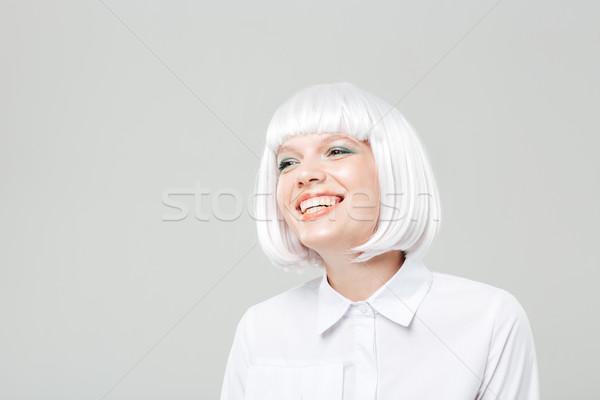 幸せ 魅力的な 若い女性 ブロンド かつら 立って ストックフォト © deandrobot