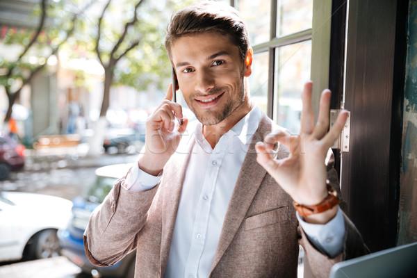 бизнесмен мобильного телефона вызывать жест Сток-фото © deandrobot