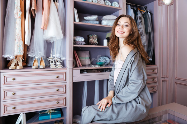 Beautiful young woman don't know what to wear Stock photo © deandrobot