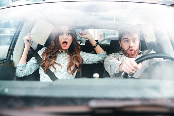 Scared couple in car Stock photo © deandrobot