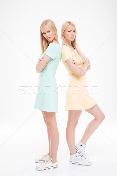Two angry women standing back to each other Stock photo © deandrobot