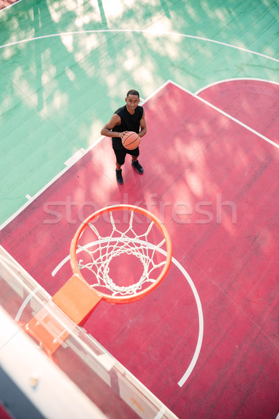 Attractive african basketball player practicing Stock photo © deandrobot