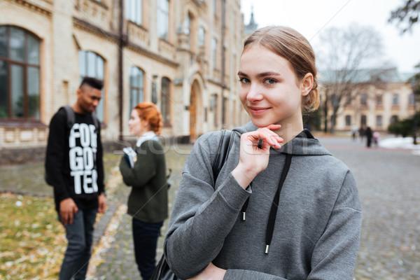 счастливым женщину студент рюкзак Постоянный за пределами Сток-фото © deandrobot