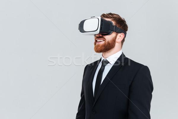 üzletember virtuális valóság berendezés fiatal szakállas Stock fotó © deandrobot