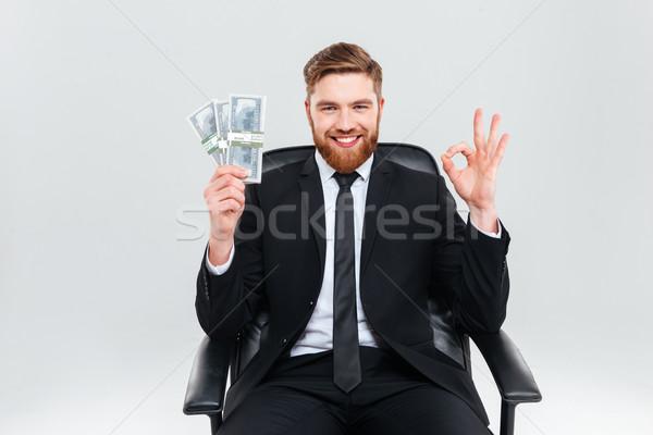Szczęśliwy człowiek biznesu ceny fotel uśmiechnięty czarny garnitur Zdjęcia stock © deandrobot