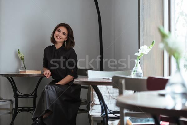 Güzel bayan oturma pencere kafe görüntü Stok fotoğraf © deandrobot