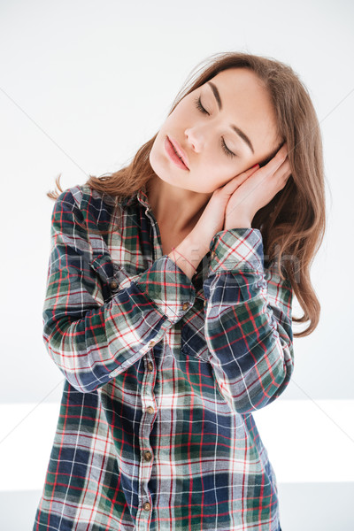 Pretty woman sleeping on her hands Stock photo © deandrobot