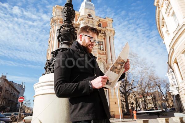 Yandan görünüş sakallı adam kat gazete gözlük Stok fotoğraf © deandrobot