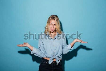 Vertical image of mystery woman in bathrobe holding book Stock photo © deandrobot