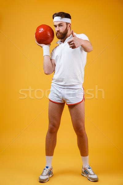 красивый серьезный молодые спортсмен мяча Сток-фото © deandrobot