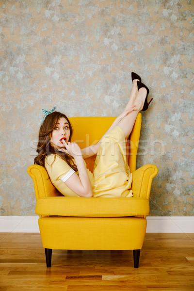 вертикальный изображение удивленный женщину кресло желтый Сток-фото © deandrobot