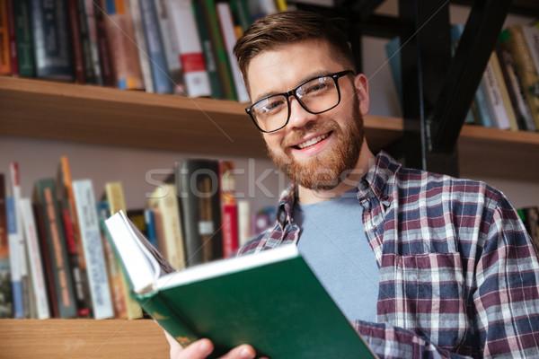 Glimlachend jonge mannelijke student bril Stockfoto © deandrobot