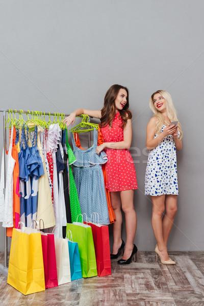 Függőleges kép két nő áll fogas ruha Stock fotó © deandrobot