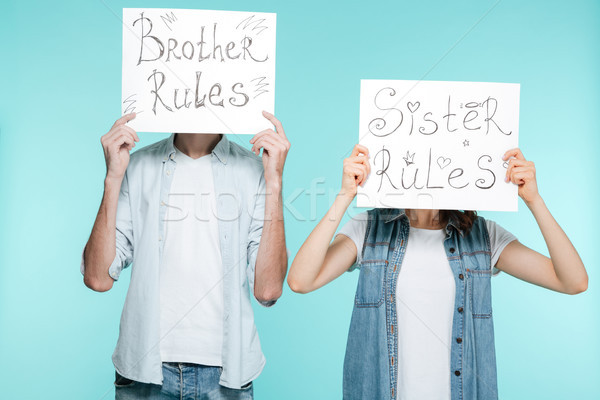 Brother and sister holding funny nameplates Stock photo © deandrobot