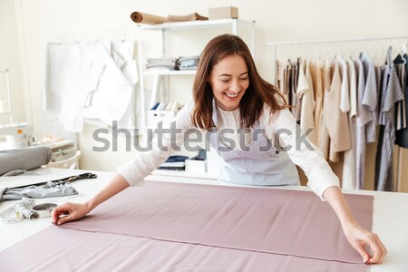 Concentrated seamstress making patterns Stock photo © deandrobot
