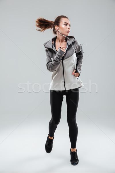 фотография Привлекательная женщина Runner работает студию Сток-фото © deandrobot