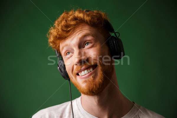 Stock photo: Close-up portrait of happy hipster readhead man listening music