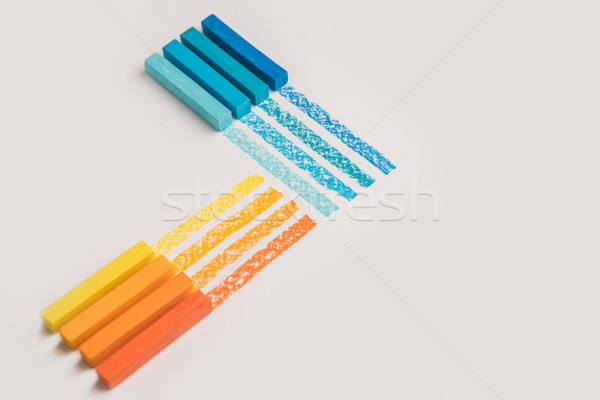 Stock photo: Close up of color pastel crayon chalks over its own trace line