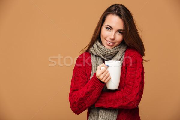 Szczęśliwy pani sweter pitnej hot Zdjęcia stock © deandrobot