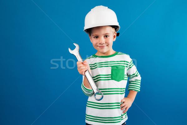 улыбаясь шлема позируют ключа подобно Сток-фото © deandrobot
