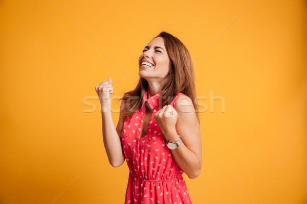Közelkép érzelmes fiatal ünnepel nő csukott szemmel Stock fotó © deandrobot