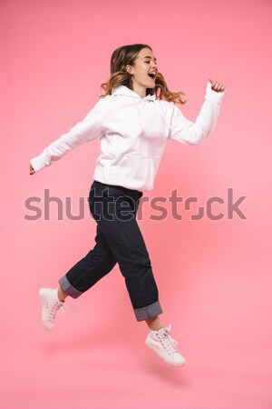 Excited happy young woman holding balloons. Eyes closed. Stock photo © deandrobot