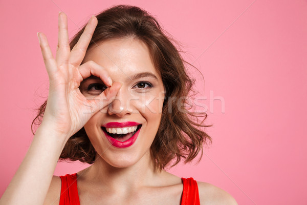 Close-up portrait of young happy girl with red lips looking at c Stock photo © deandrobot
