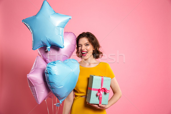 Close-up photo of playful birthday girl with red lips winks one  Stock photo © deandrobot